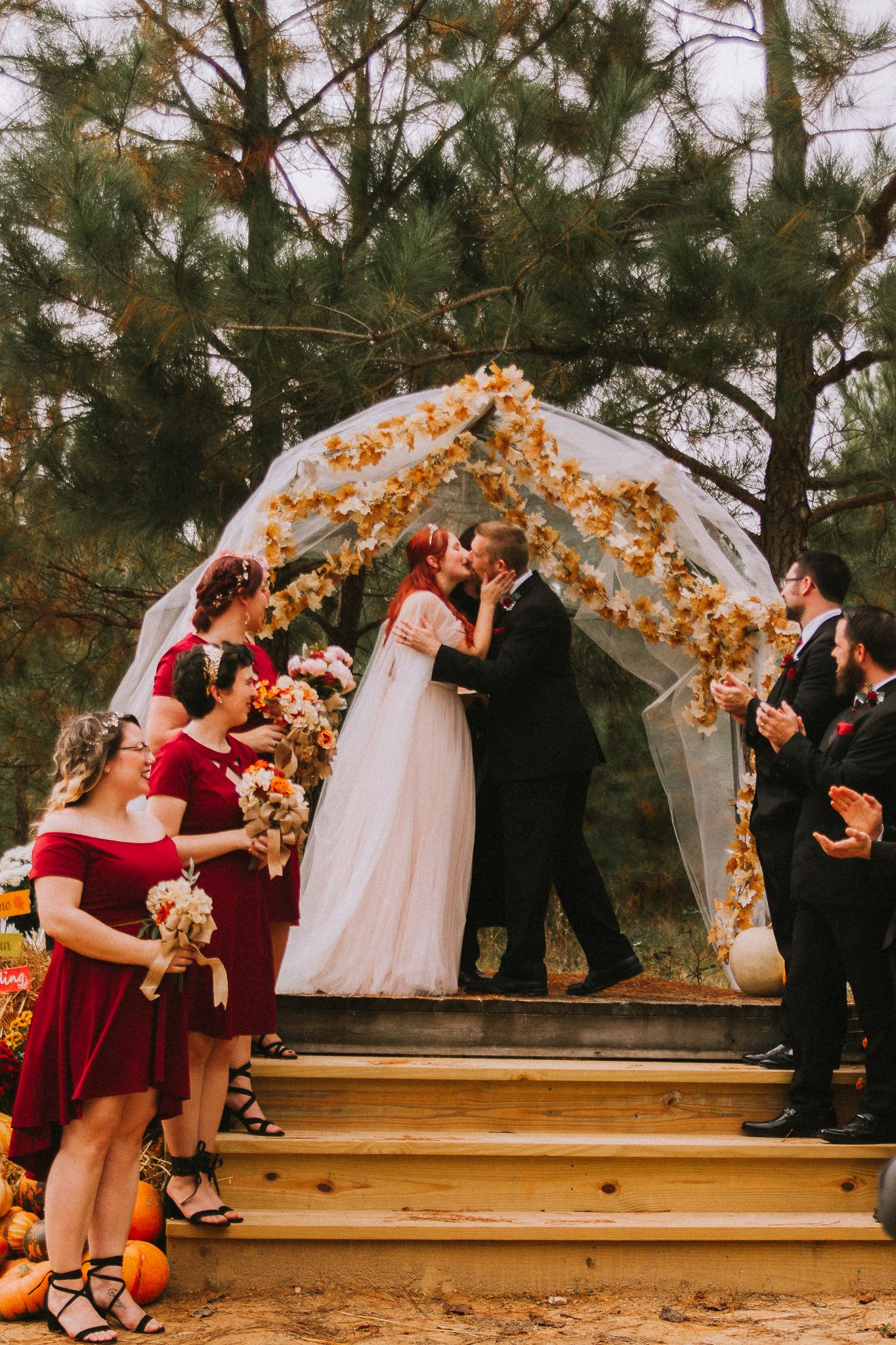 groom kisses the bride after they are married