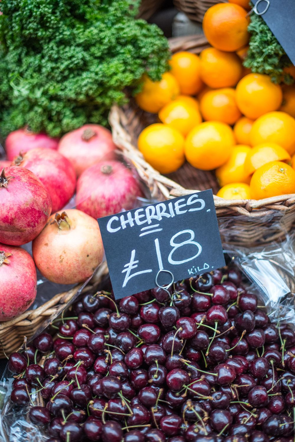Cherries, oranges, and pomegranates at Borough Market, London