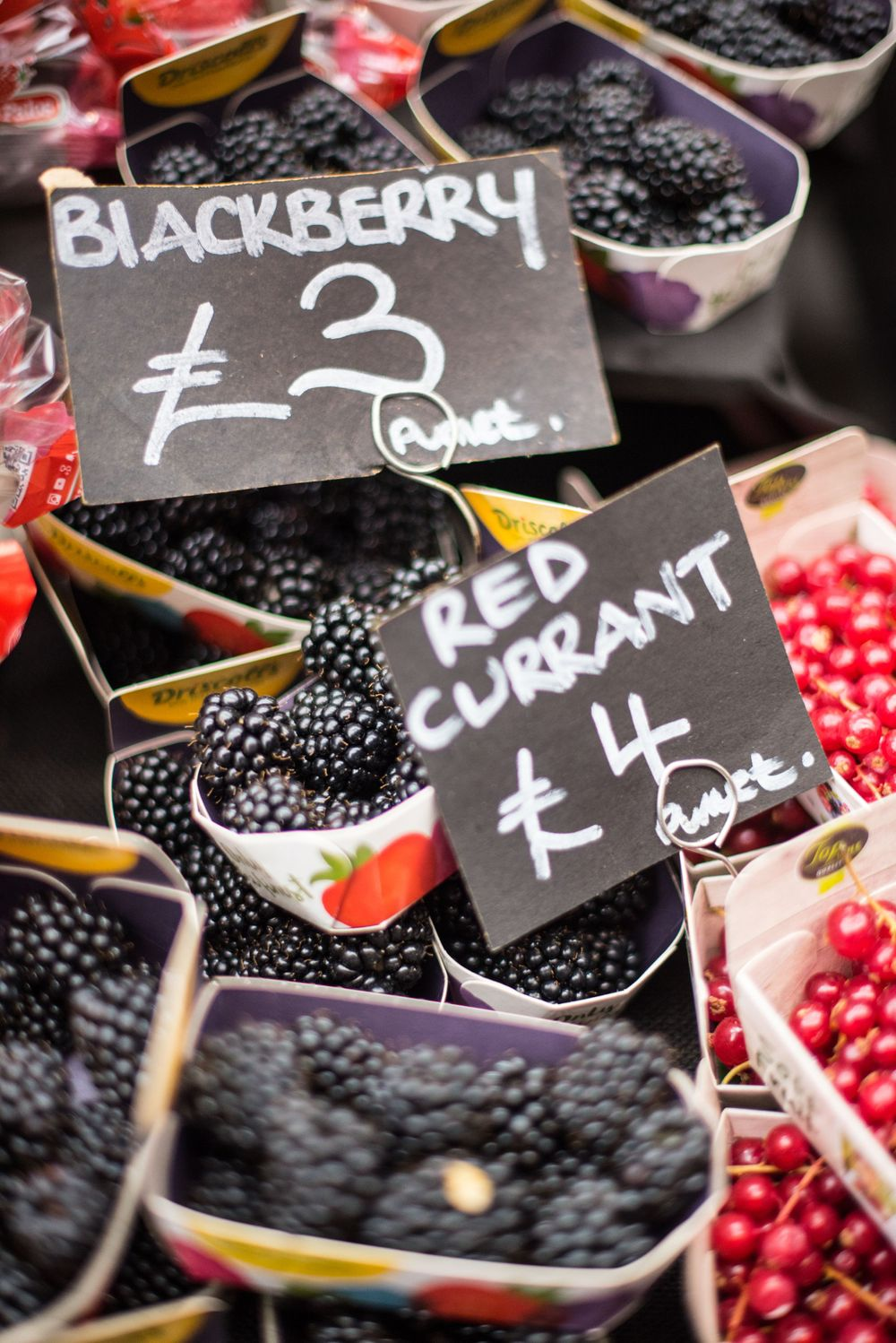 Blackberry and red currant display at Borough Market, London