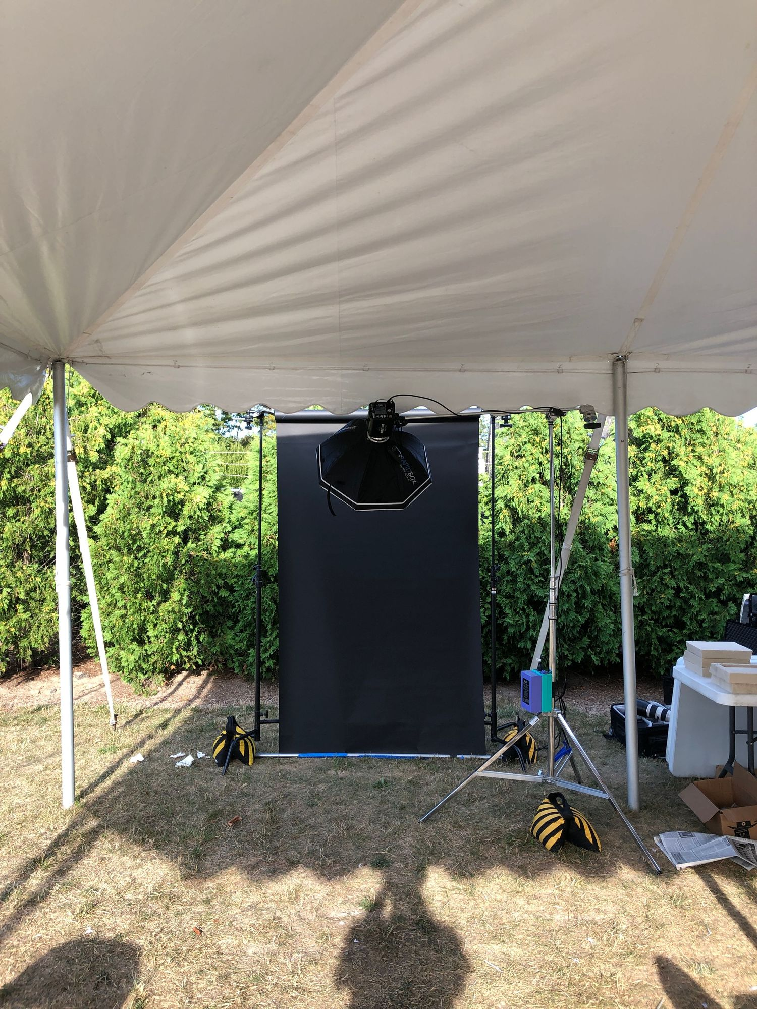 Mobile portrait photography studio under a tent