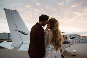 couple-kissing-next-to-plane-at-sunset-ankeny-iowa-raelyn-ramey-photography