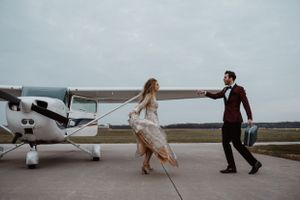 couple-dancing-in-front-of-small-plane-ankeny-iowa-raelyn-ramey-photography