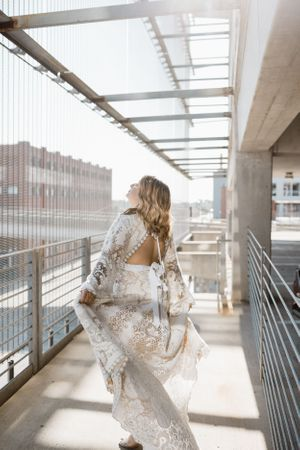 bride-dancing-around-in-dame-and-maiden-wedding-dress-desmoines-iowa-raelyn-ramey-photography