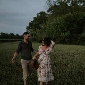 maternity-couple-walking-laughing-easter-lake-raelyn-ramey-photography