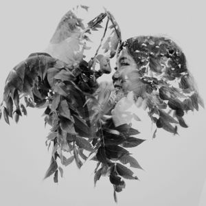 double-exposure-couple-with-leaves-winterset-iowa-raelyn-ramey-photography