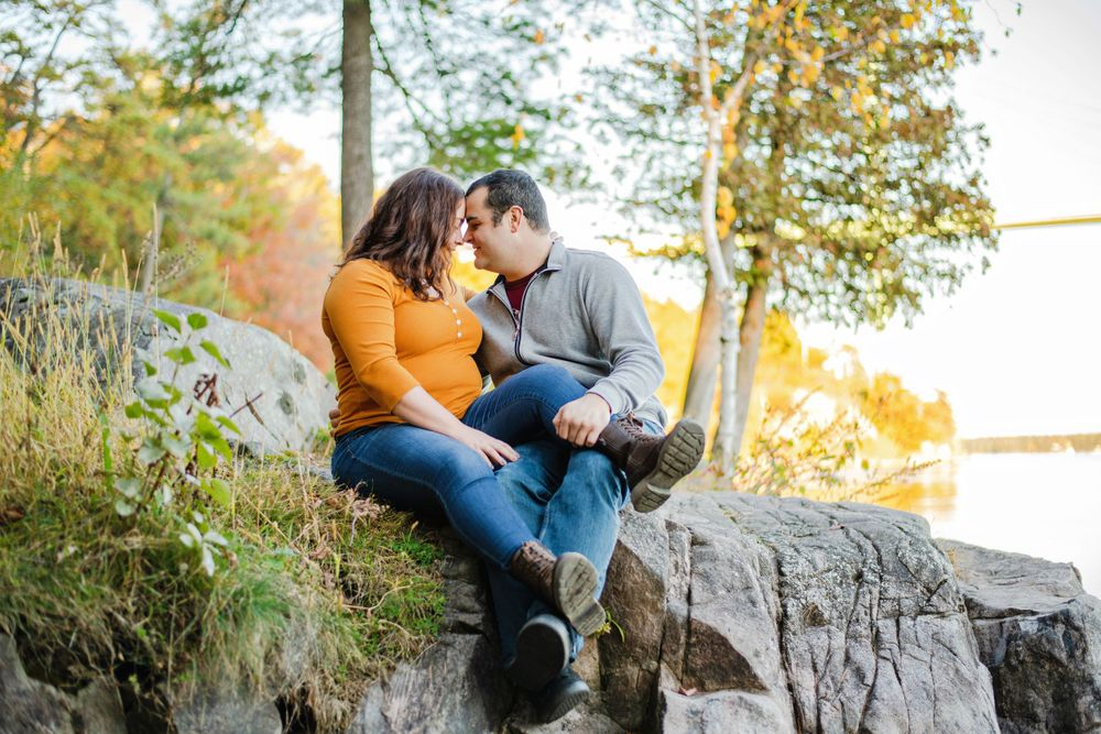 Kingston Couples Photography - Couple touching foreheads while sitting on rock