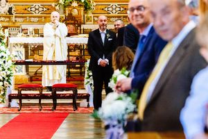 photography of groom watching bride arriving at wedding in Ferrara Italy