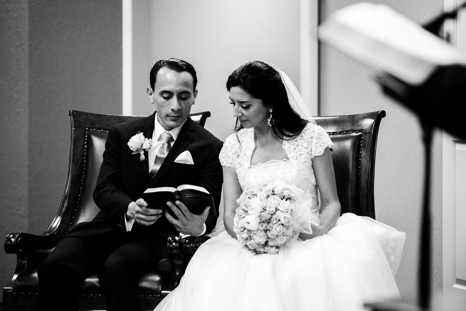 Bride and groom read a scripture during Kingdom Hall wedding ceremony of Jehovah's Witnesses