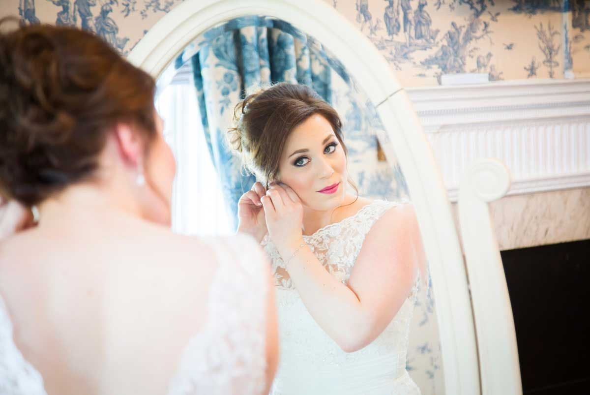Brides reflection in mirror getting ready