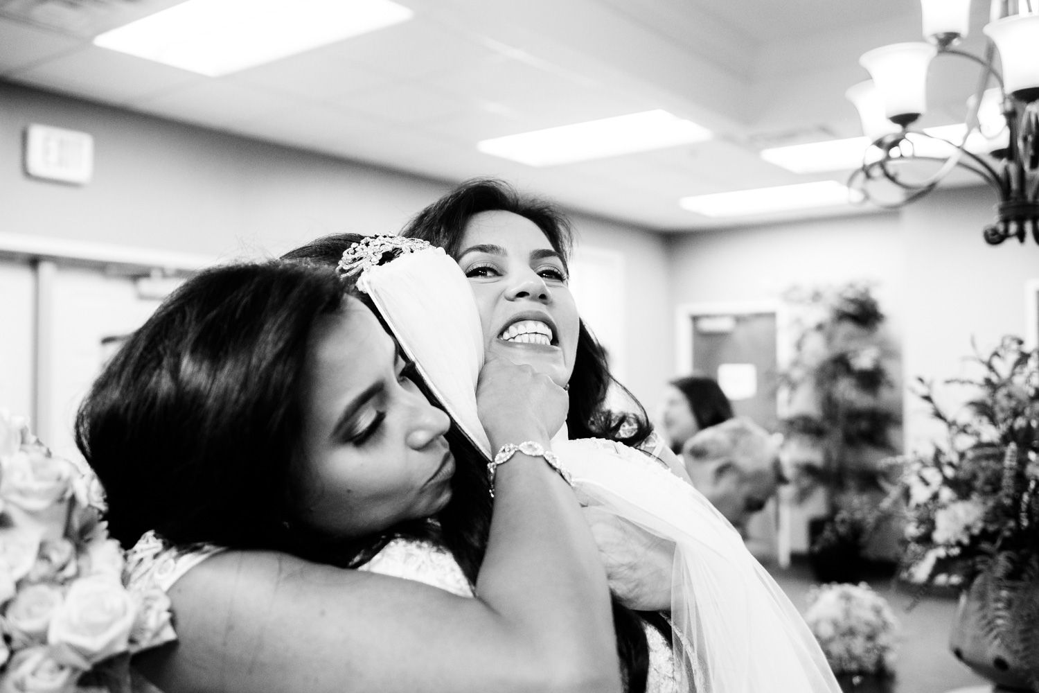 Bride hugs bridesmaids after ceremony
