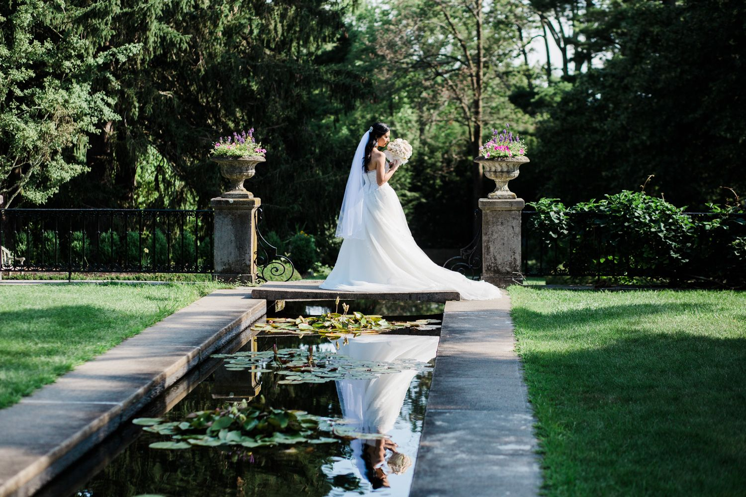 Bride reflected in pool at Skylands Manor