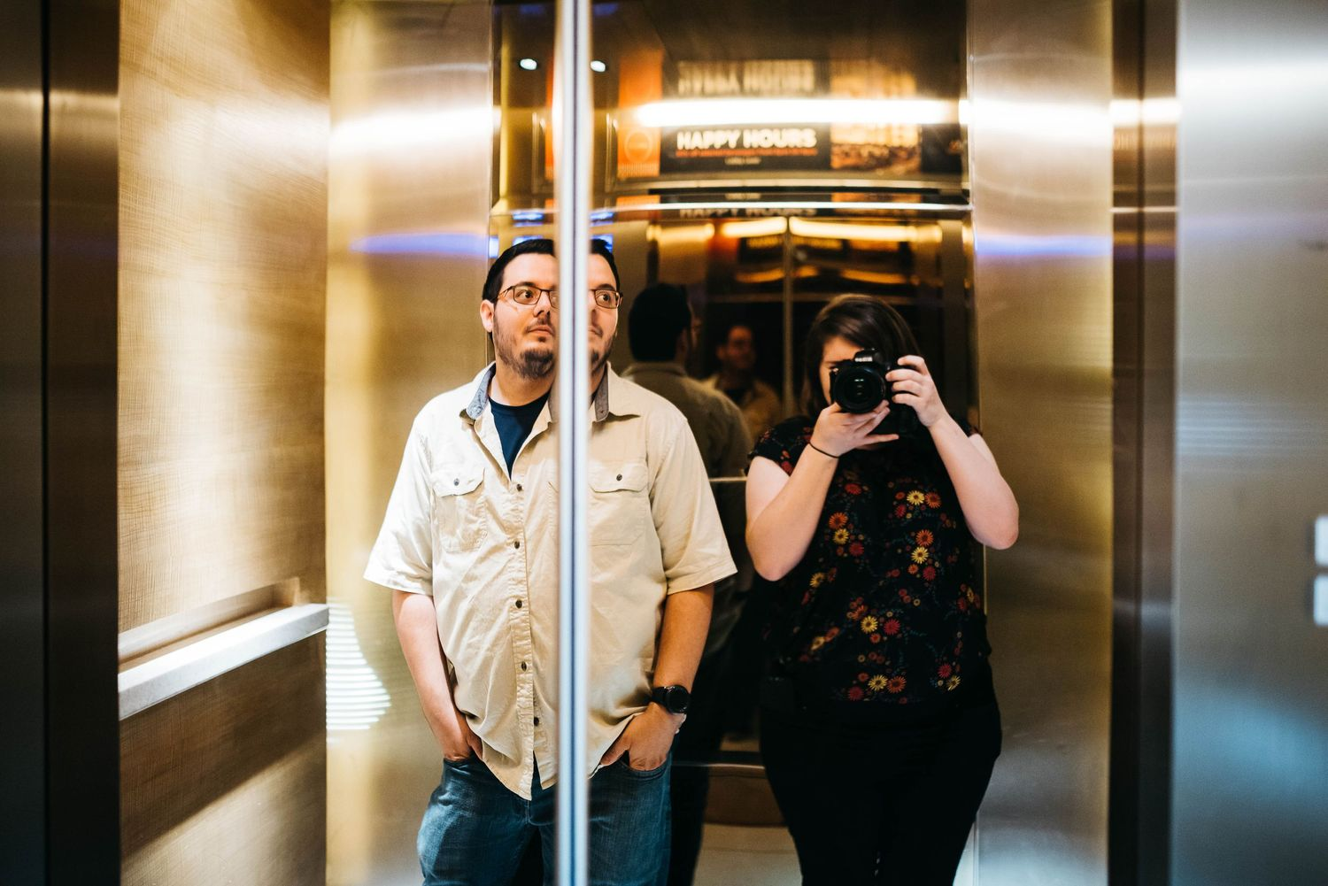 Taylor Moore of Taylor Moore Portraiture with her boyfriend in an elevator in Kuala Lumpur
