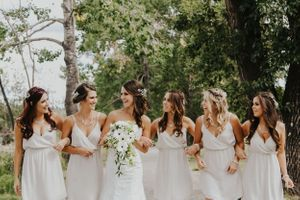 Bridesmaids talk and life while walking arm in arm