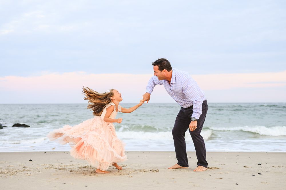 daddy and daughter dancing on the beach in spring lake