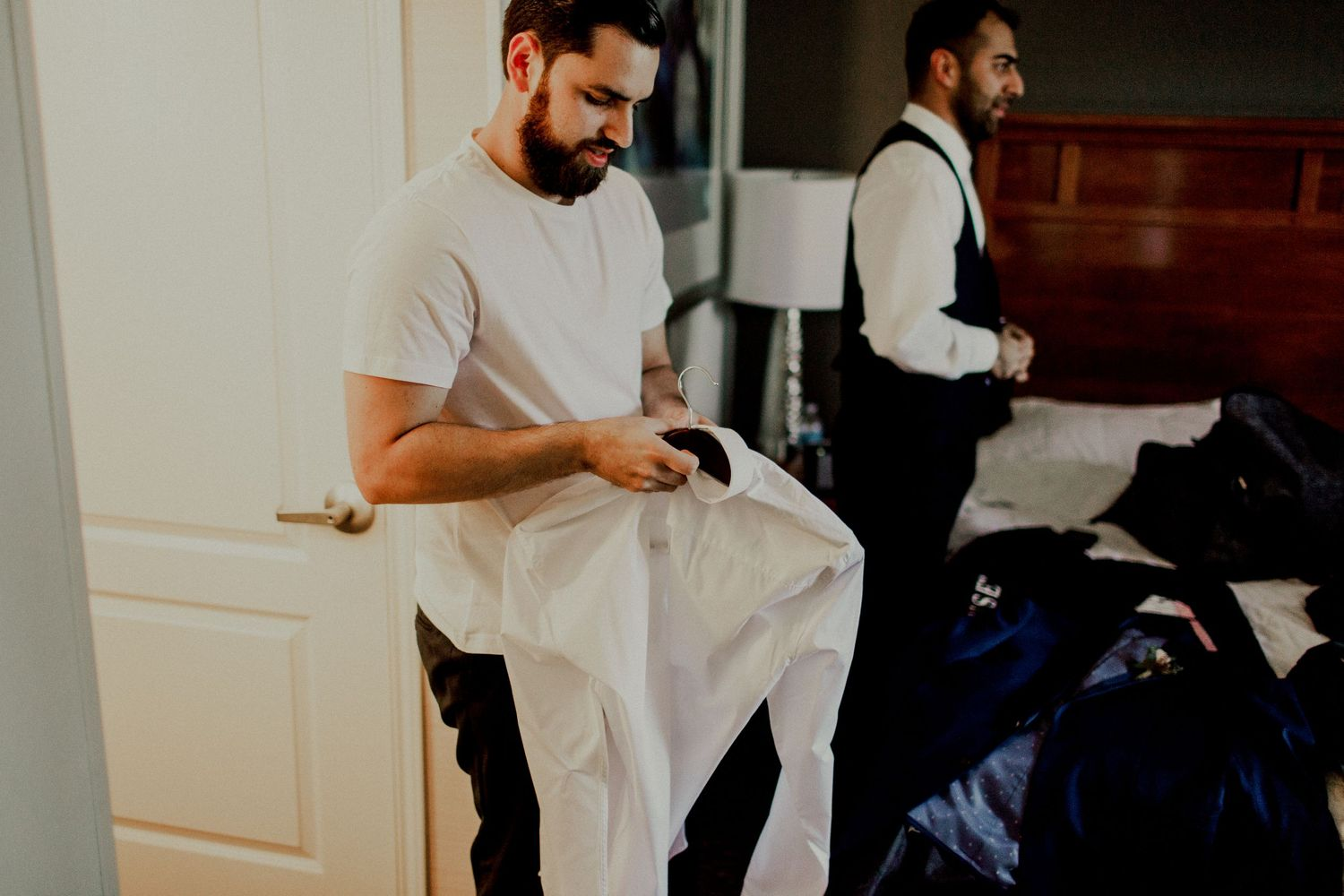 groom prepping for wedding day at holiday inn
