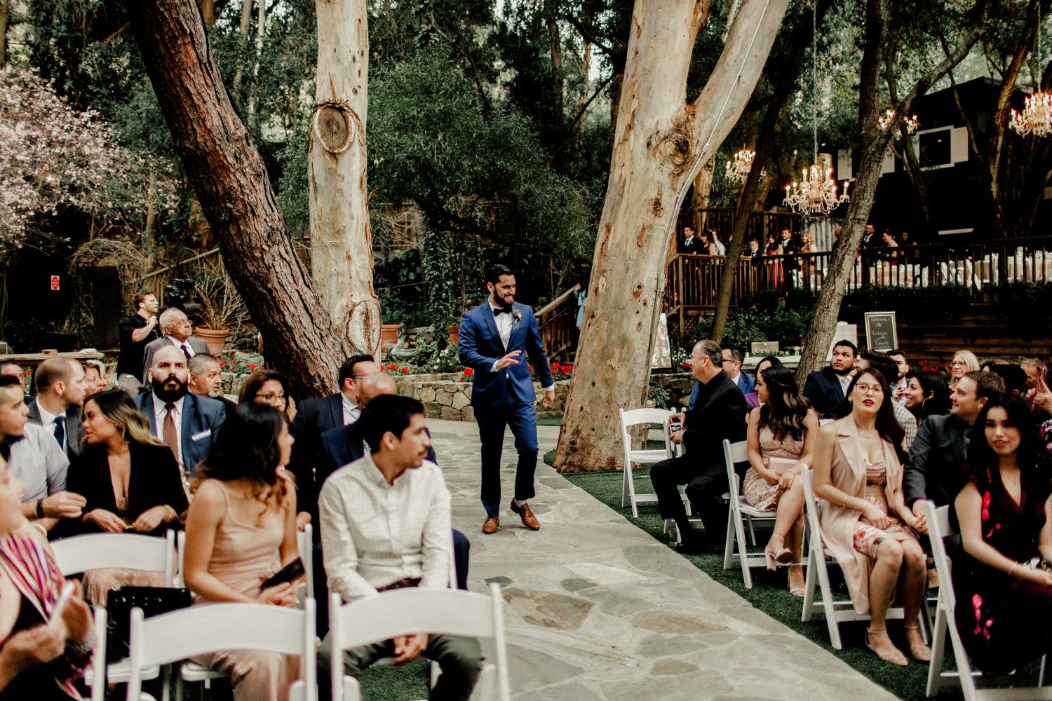 groom walking down altar at wedding ceremony calamigos ranch malibu