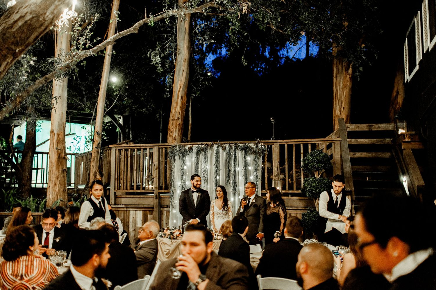 wide shot of father saying speech at rodaina and robert's wedding at calamigos ranch malibu