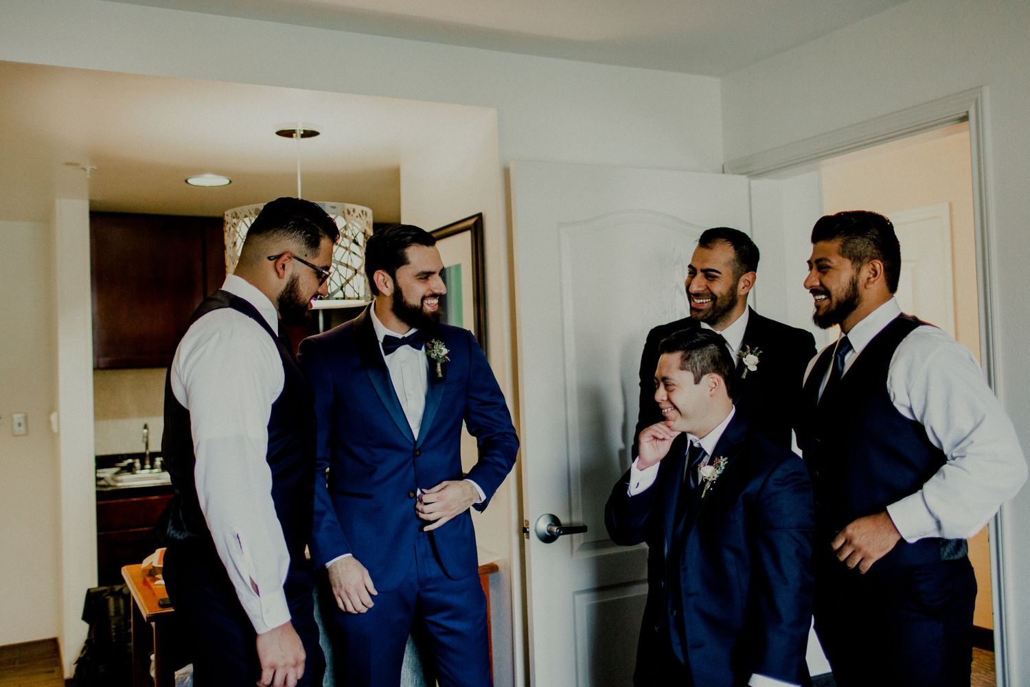 candid of groomsmen talking