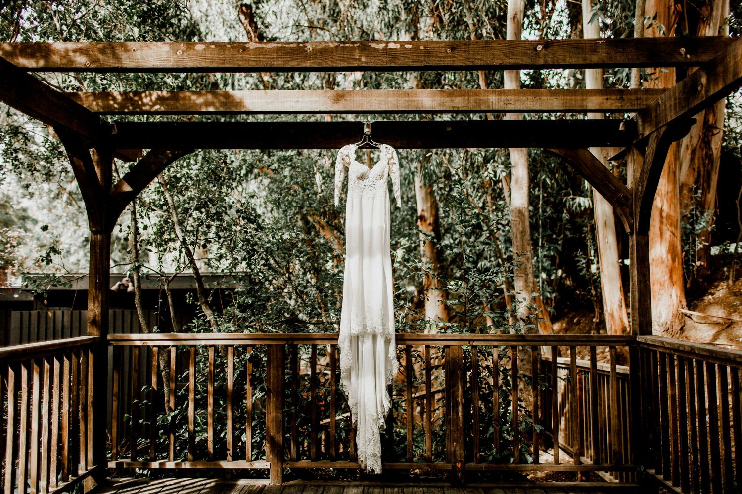 bride's wedding dress hanging on porch at calamigos ranch malibu