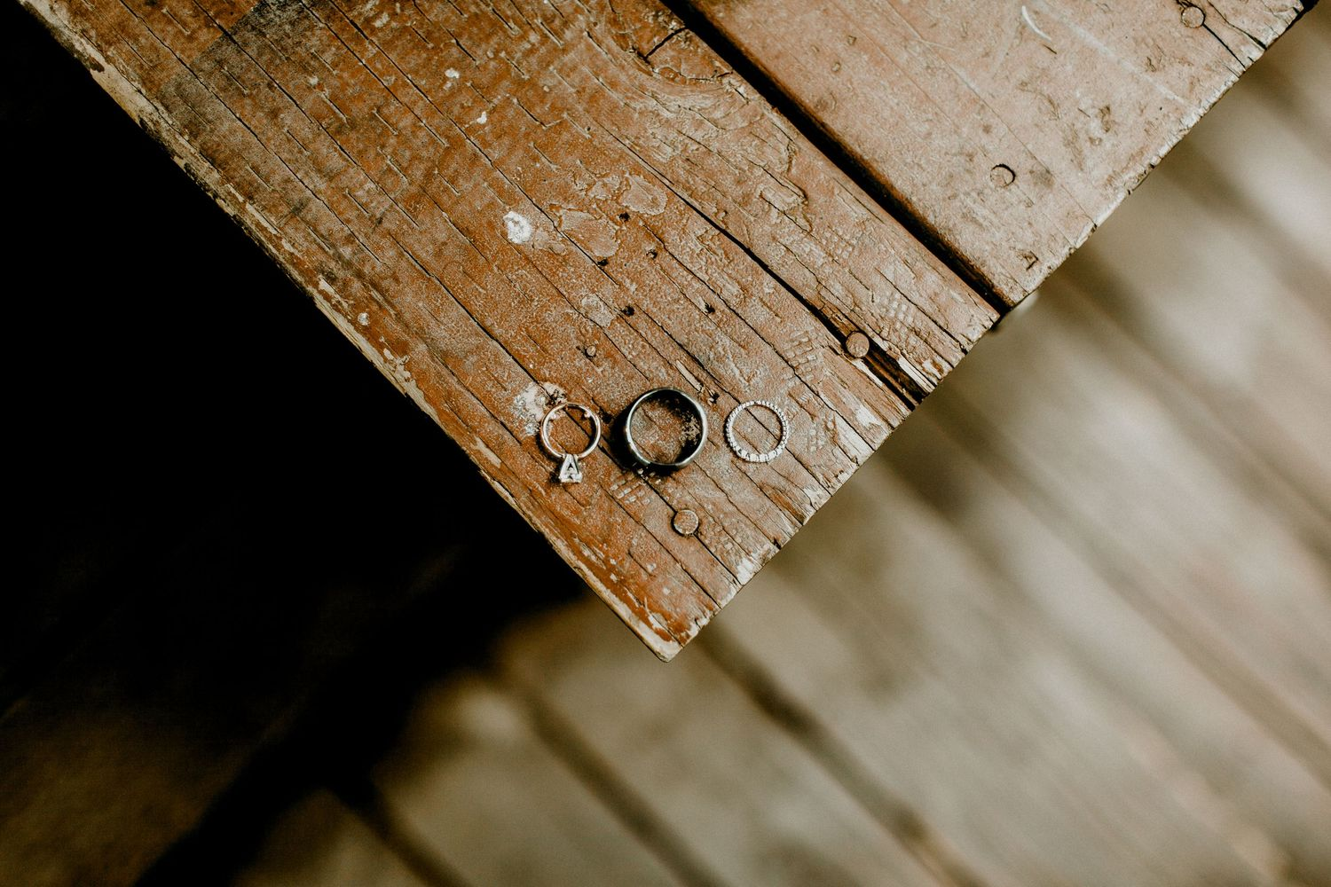 detailed image of wedding bands on a wooden bench at calamigos ranch