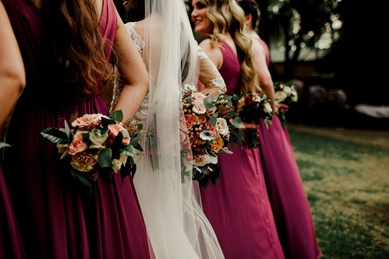 bridal party holding bouquet's behind back