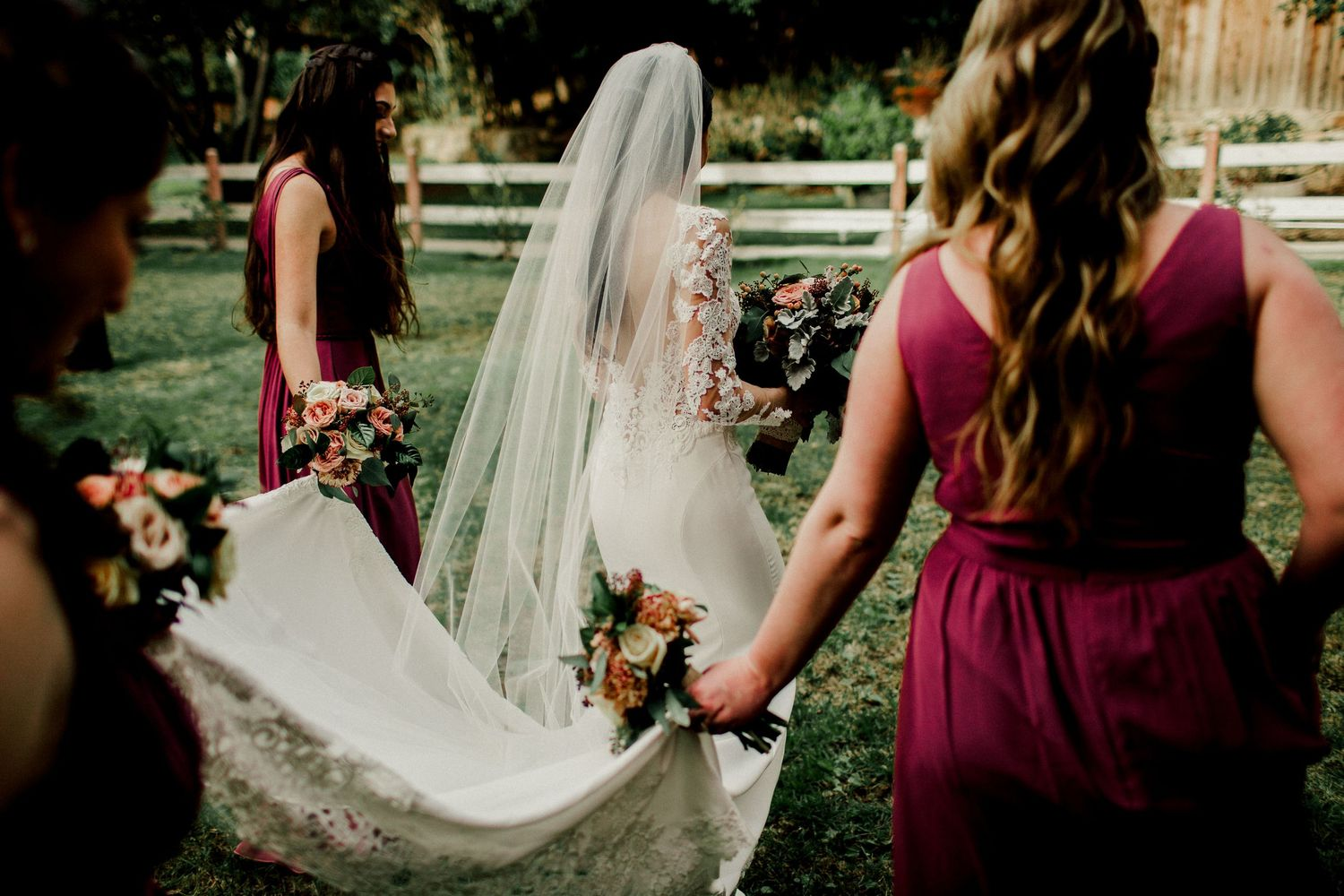 bridal party walking helping bride with dress calamigos ranch malibu