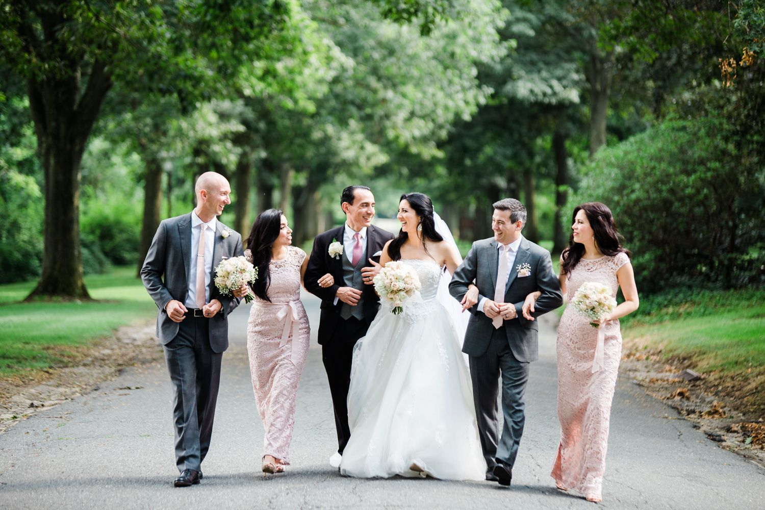 Wedding party wearing blush lace and grey at Skylands Manor