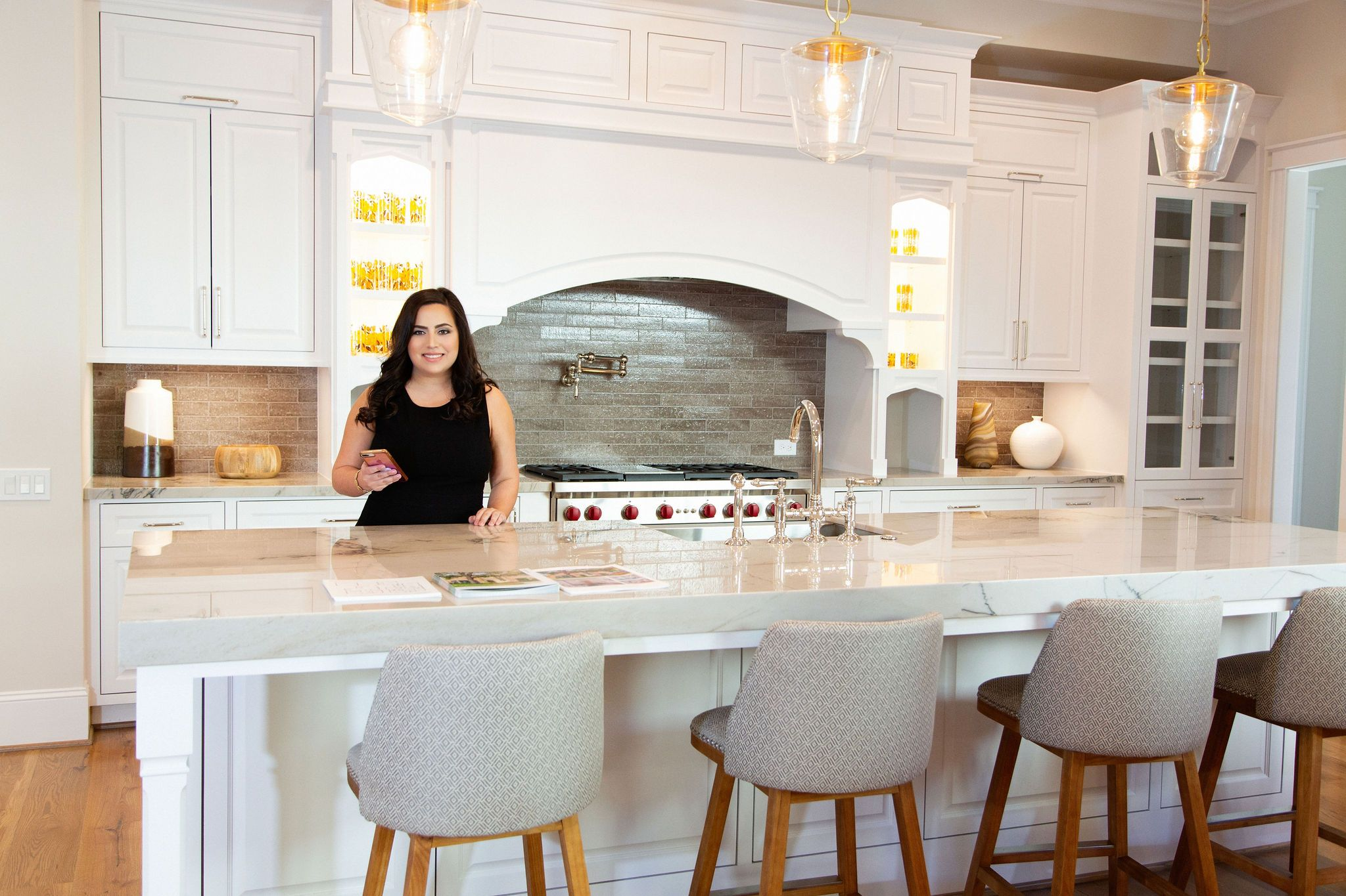 Realtor Laura Miranda preparing to show million dollar home in Houston River Oaks District