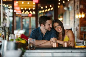 fiancé looking at his fiancee during engagement session at Finka restaurant in Miami