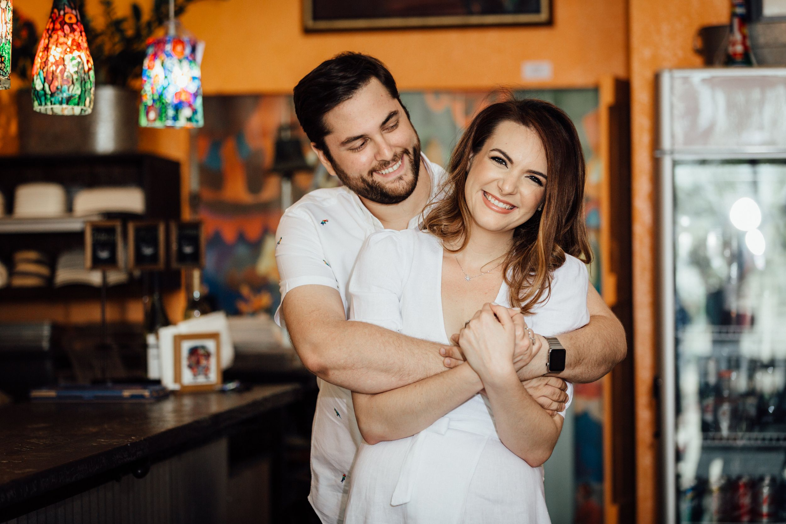 couple hugging each other during engagement session at Agustin Gainza Arts and Tavern in Miami Florida
