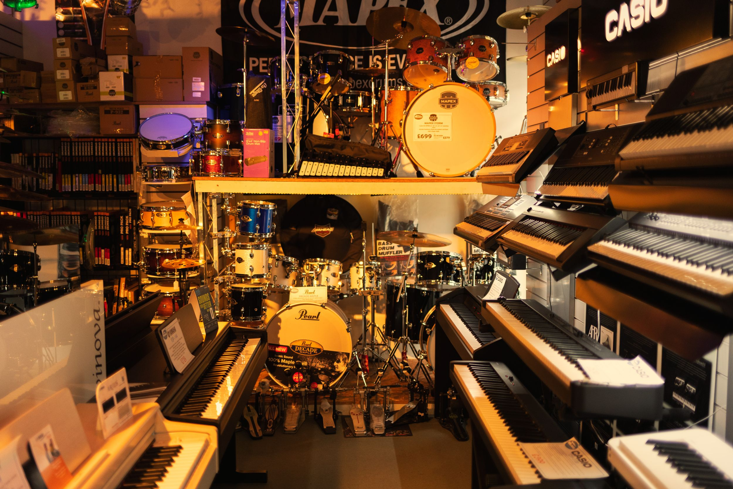 Collection of pianos, keyboards and drums.