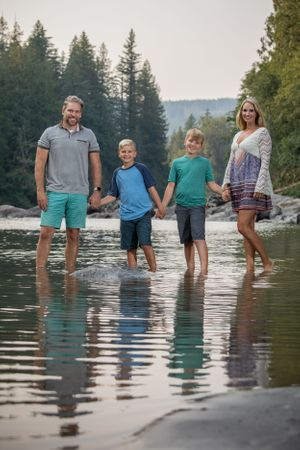 A family standing in a river.