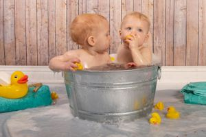 Little boy brothers in a bath together.