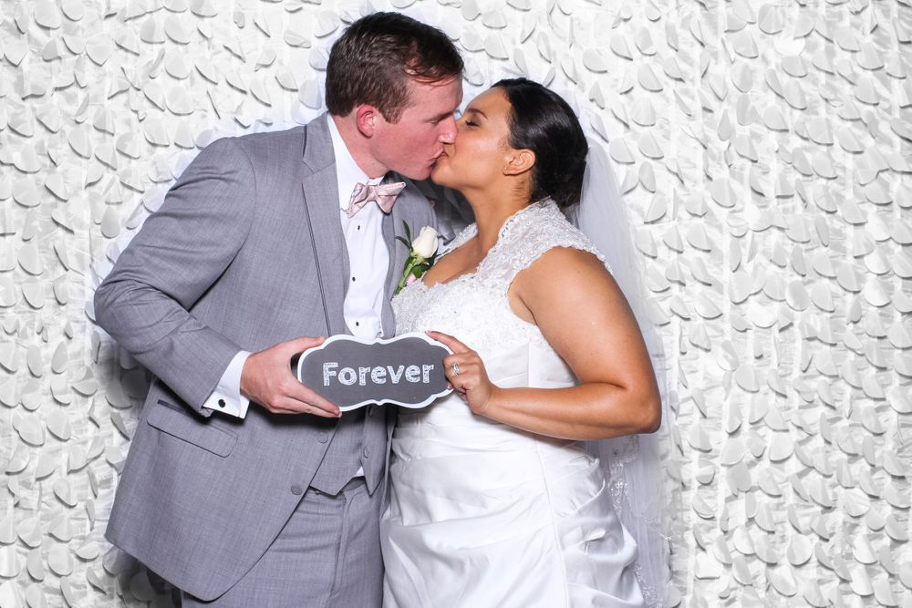 Bride and Groom kiss at Gigglebox Photo Booth