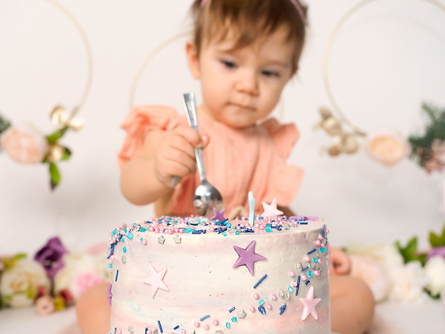 Baby girl eats cake at a Cake Smash session in Mödling, Austria