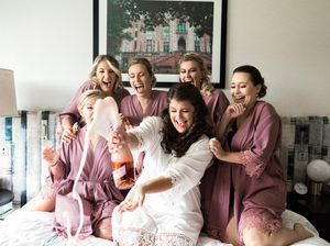 Bride and Bridesmaids Popping Champagne, Oaklander Hotel