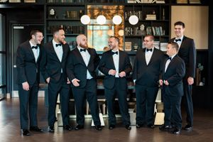 groomsmen in front of bar