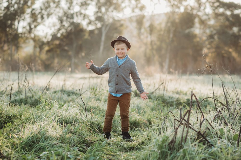 Boy happy standing at sunrise