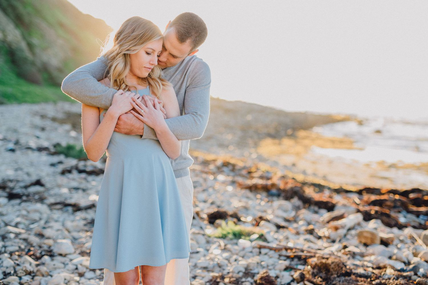 hug on beach engagement photo