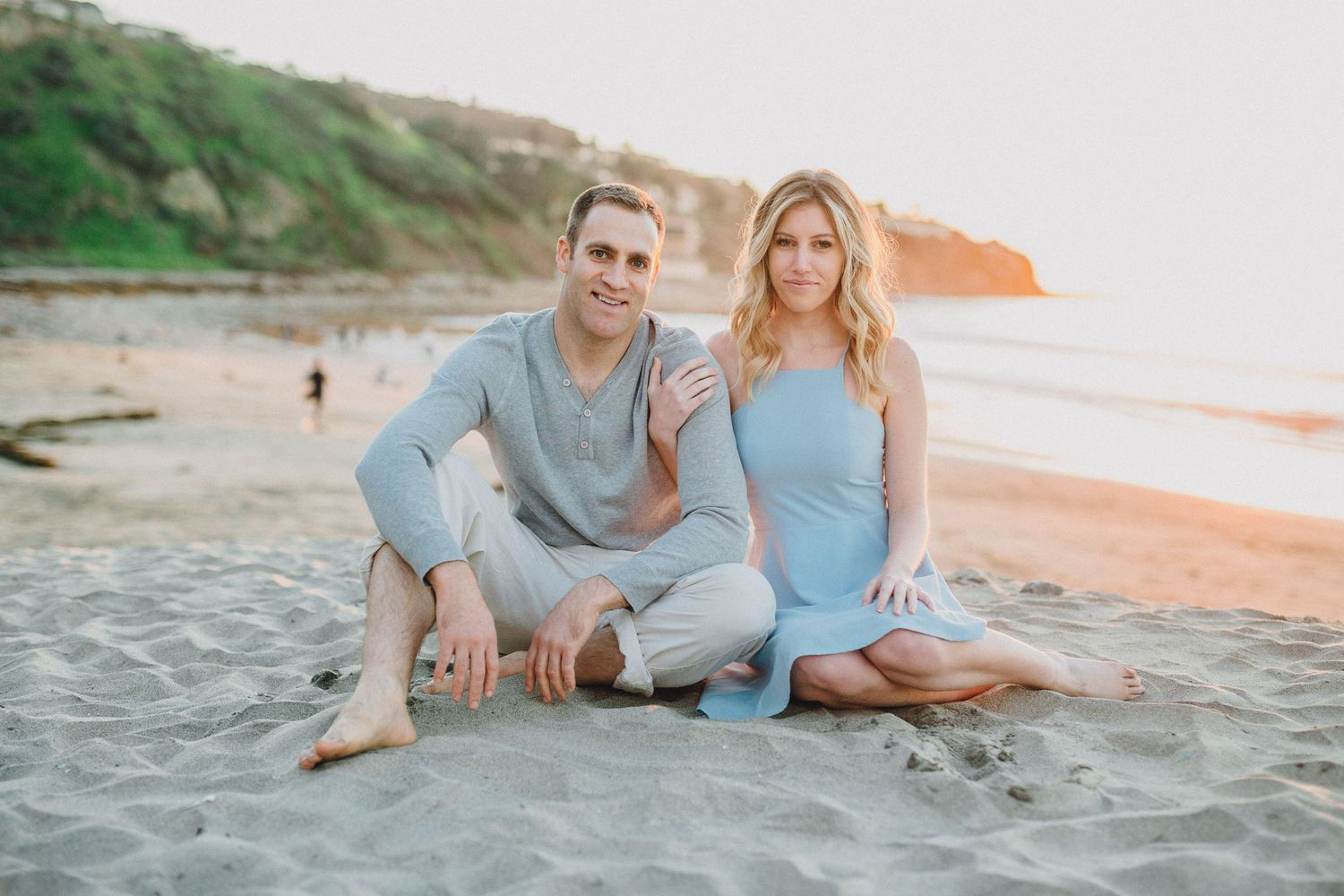 sitting on beach engagement photo