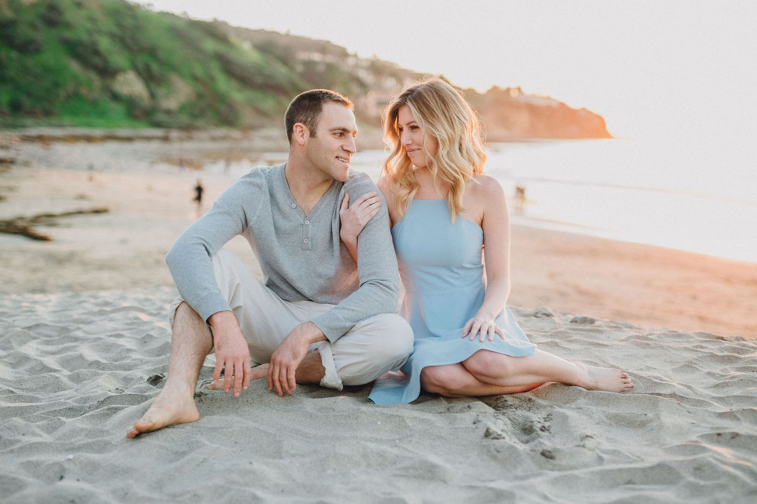 sitting on sand engagement photo