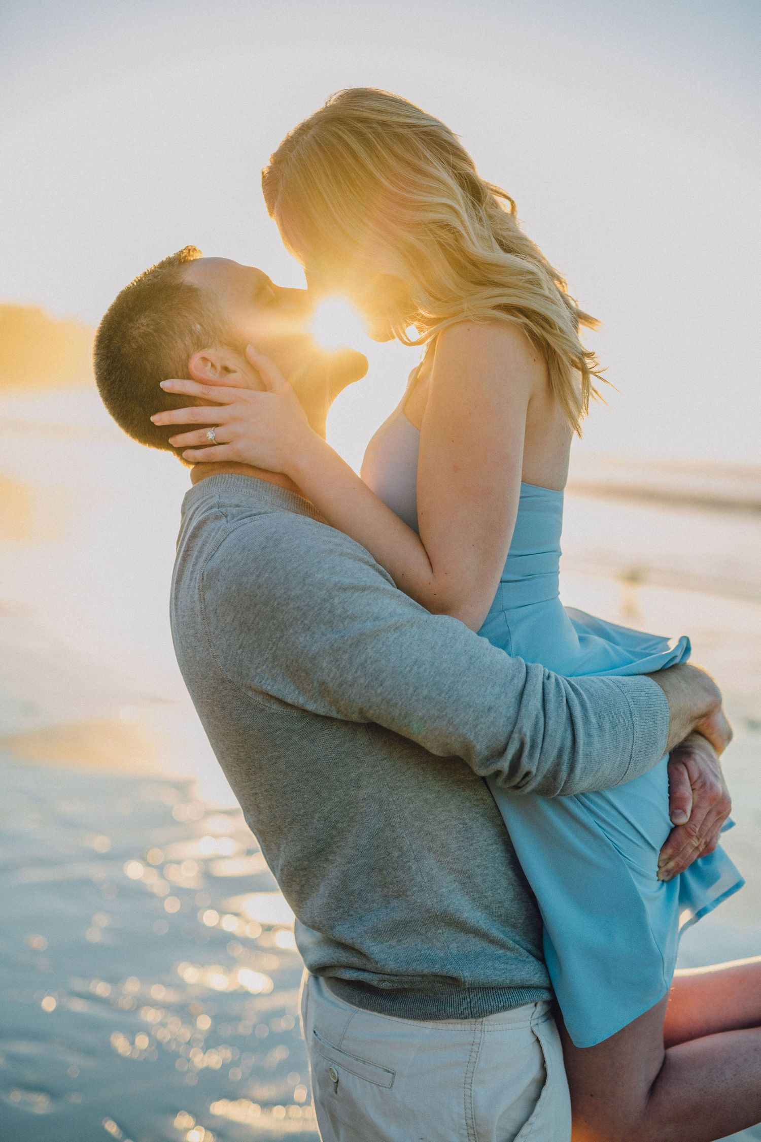 sunlit kiss engagement photo