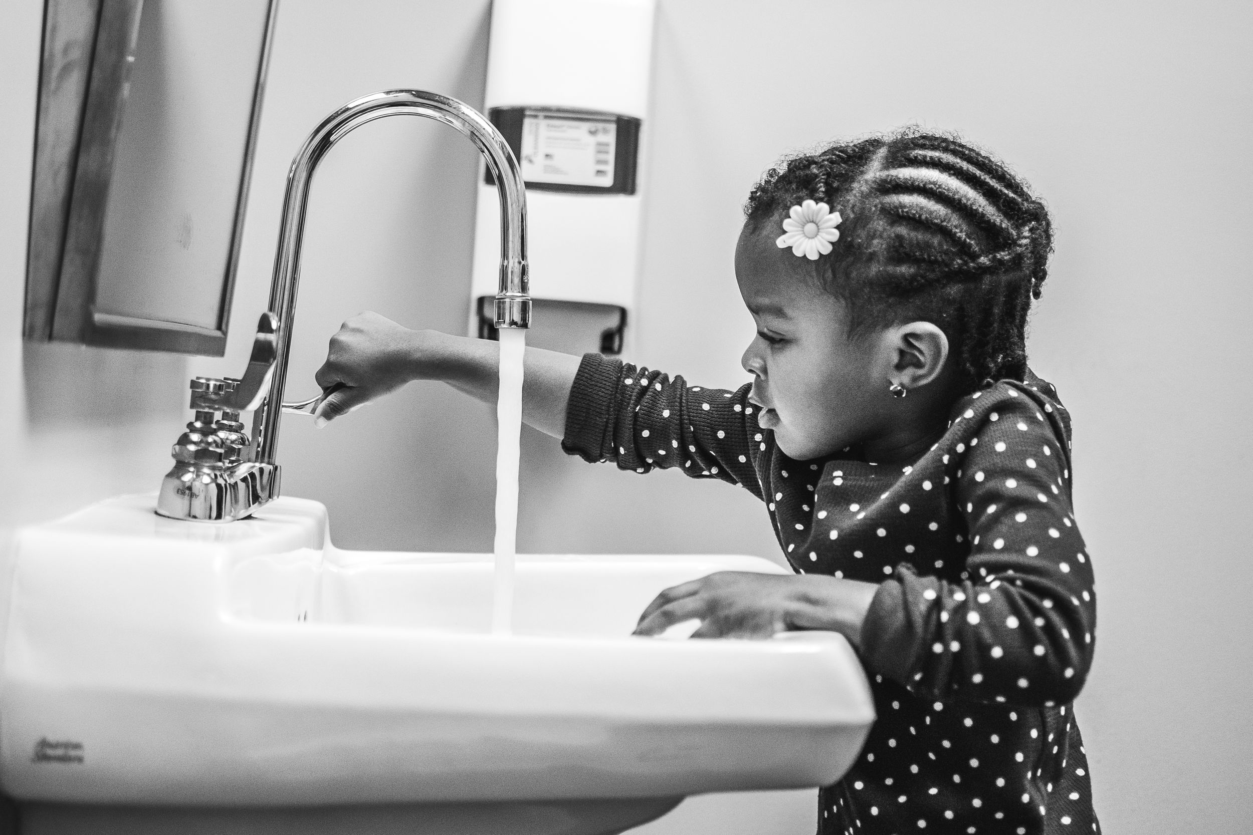 little-girl-washing-her-hands-at-the-sink