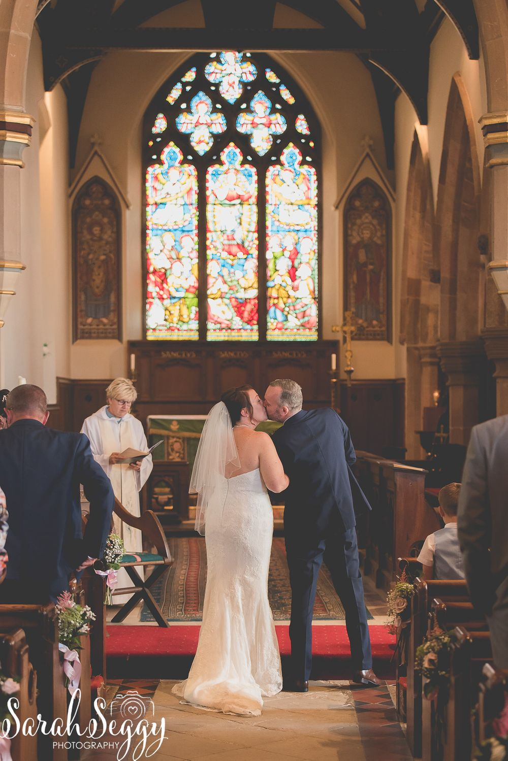 Braunston church, Daventry, bride and groom, first kiss