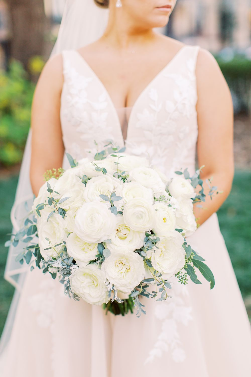 bride shows off beautiful bouquet made by kato floral design in downtown savannah, ga