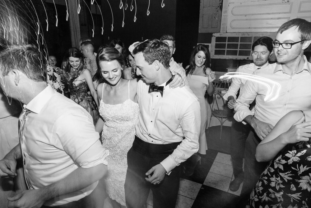 bride and groom dance during their wedding reception at soho cafe in savannah, ga