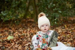 Little girl playing leaves at rufford abbey
