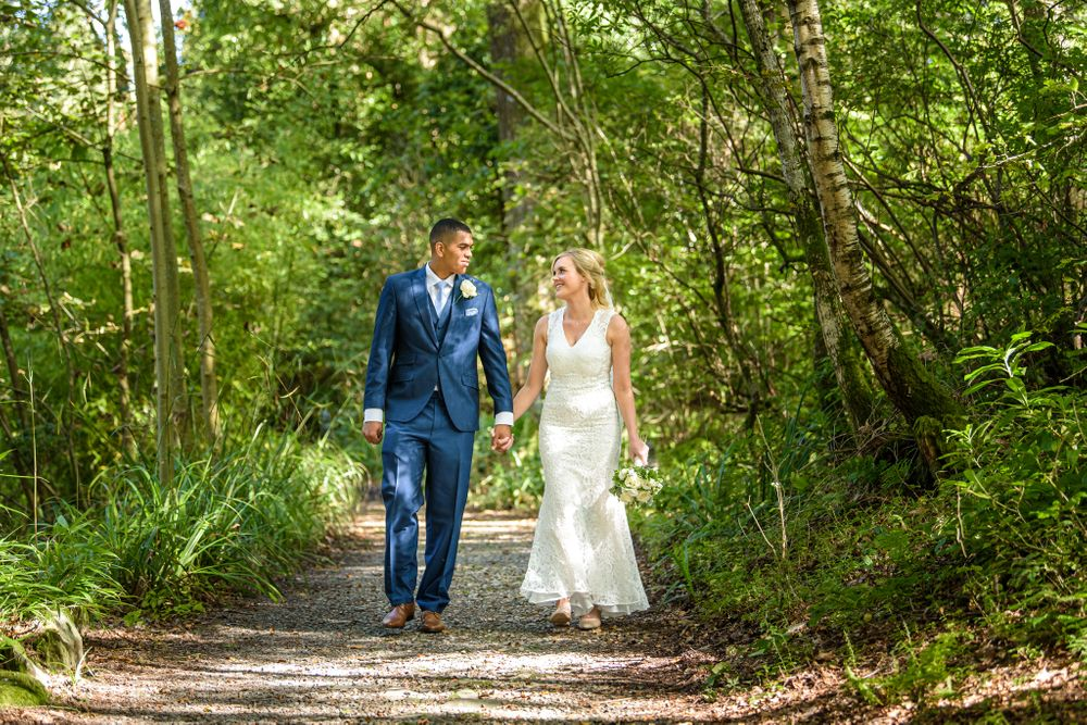 Couple in woods after elopement wedding