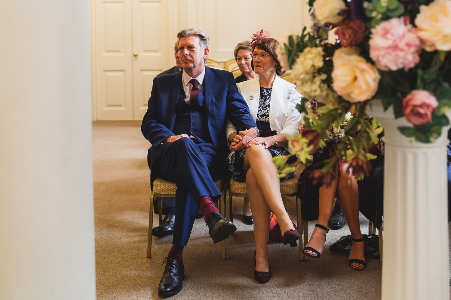 Bride's mother and father look on as their daughter gets married at Salisbury Registry Office.