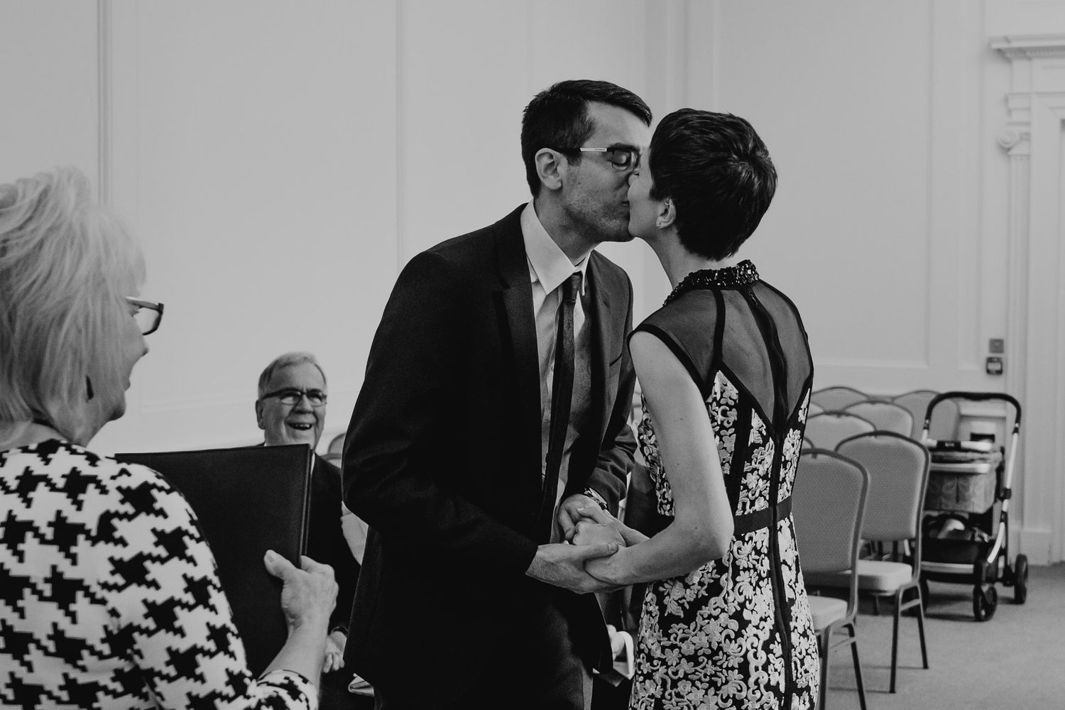 Black and white photo of bride and groom's first kiss at Salisbury Registry Office.
